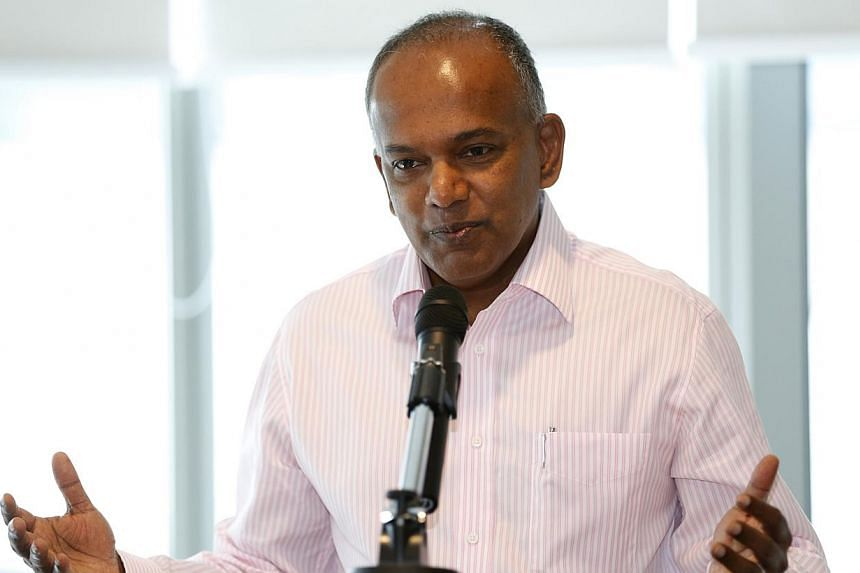 """The study of law provides an excellent training of the mind, so I don't want to be seen as discouraging people... but you have to have a realistic understanding of the market, the economy, the total structure,"" said Mr Shanmugam. -- ST PHOTO: KEVIN"