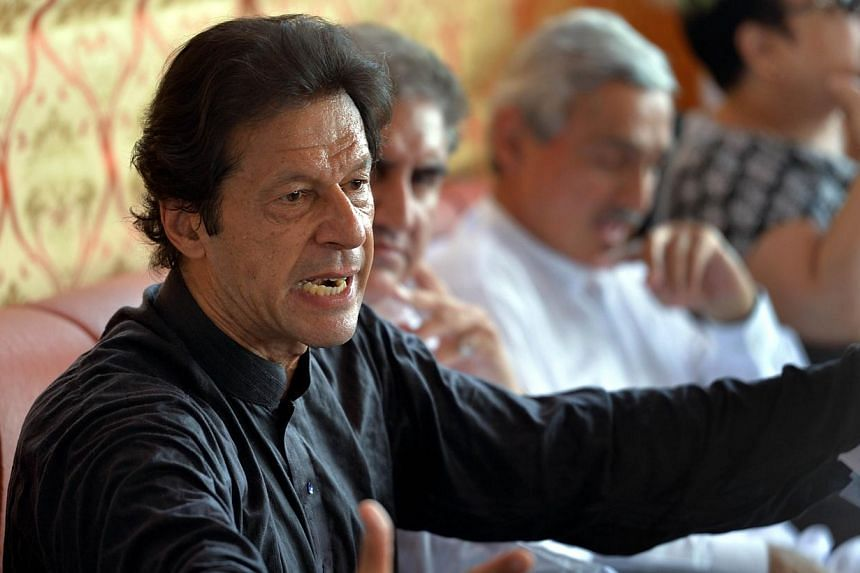 Cricketer-turned politician and chairman of Pakistan Tehreek-e-Insaf (PTI) or Movement for Justice party, Imran Khan speaks during a press conference at his residence in Islamabad on Aug 11, 2014.The PTI has decided to resign all its seats in t