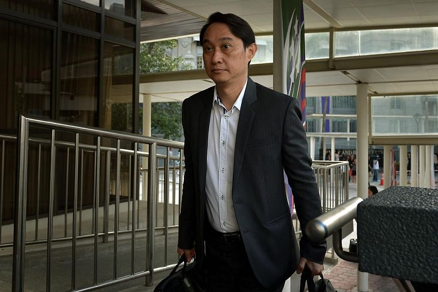 Chew Eng Han arriving at the State Courts on 11 Aug 2014.Former City Harvest treasurer Chew Eng Han called Kong Hee, the church founder, a liar in the first five minutes of trial today. -- ST PHOTO: KUA CHEE SIONG