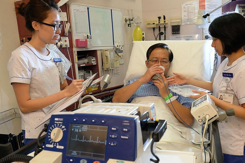 """Nurses at the National University Hospital. """"Some of them have earned degrees along the way but as a nurse, we assess you on your knowledge... ability, commitment, and not so much on where you started,"""" Mr Lee said. -- PHOTO: ST FILE"""