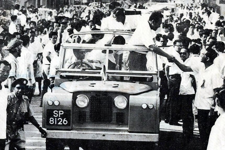 Former prime minister Lee Kuan Yew visiting constituencies in the fight against communism in Singapore, with Mr Rahmat in the driver's seat. In his National Day Rally speech, Prime Minister Lee Hsien Loong said he was the boy whose face was hidden by
