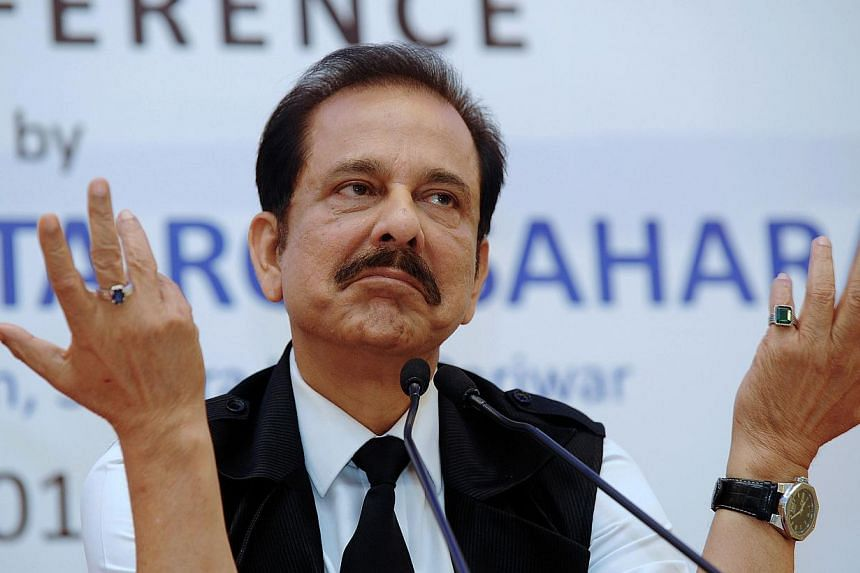 A file photo from November 2013 shows the chairman of India's Sahara Group, Subrata Roy, gesturing as he addresses a press conference in Kolkata. India's Supreme Court on August 14, 2014 gave Roy extra time to keep negotiating the sale of three luxur