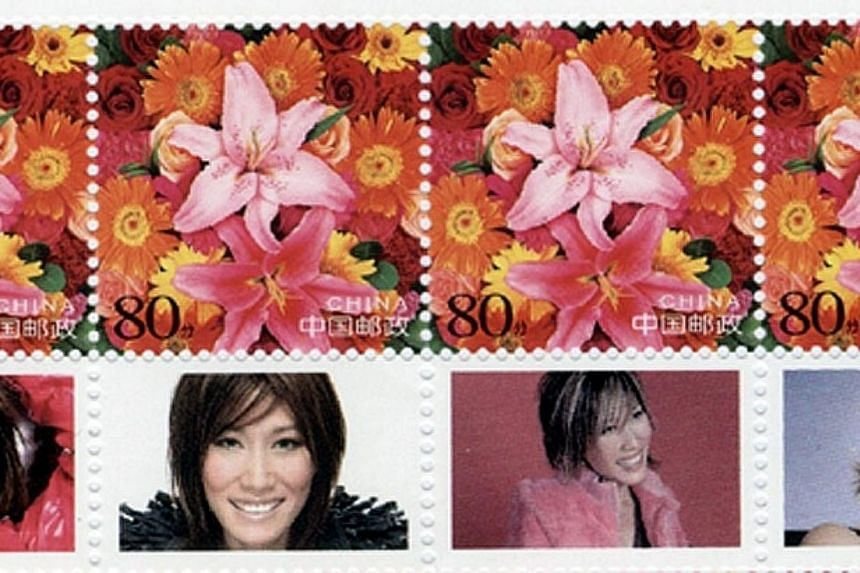 The stamps made by the Chinese government in honour of Ho Yeow Sun's contributionto charity work. -- PHOTO: ST FILE
