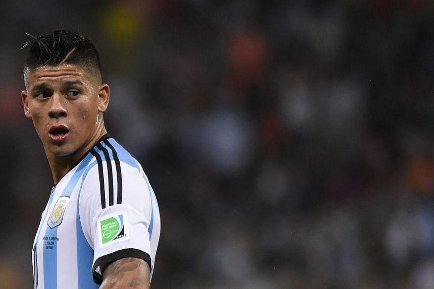 Argentina's defender Marcos Rojo reacts during the second half of extra time during the semi-final football match between Netherlands and Argentina of the FIFA World Cup on July 9, 2014. Rojo is sure that he will complete his €20 million (S$33 mill