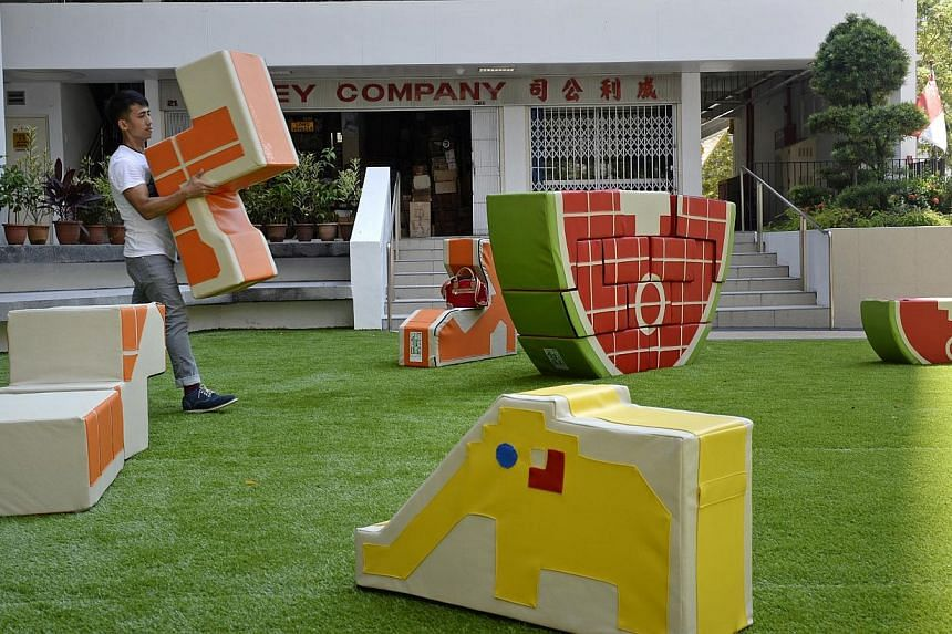 A pop-up play space at Waterloo Centre featuring 3-D jigsaw puzzles modelled after old-school playgrounds in Singapore. -- ST PHOTO: DESMOND LIM