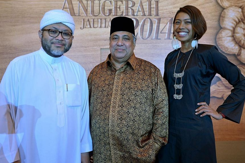 (From left) Ustaz Mohamed Hasbi Hassan and Ustaz Ali Haji Mohamed of the Religious Rehabilitation Group (RRG) won the Berita Harian Achievers of the Year Award and Saiyidah Aisyah Mohammed Rafa'ee won the Berita Harian Inspiring Young Achiever Award.