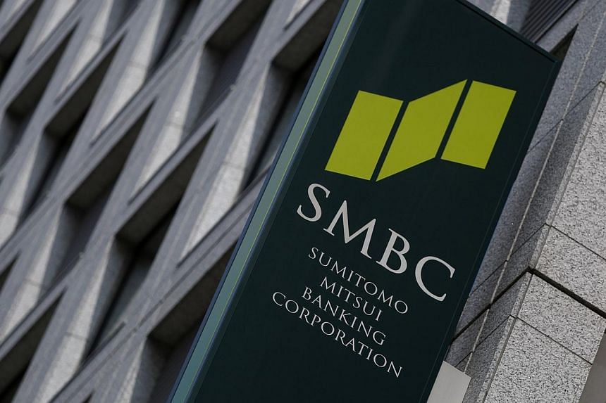 A sign board of Sumitomo Mitsui Banking Corporation is seen outside its branch in Tokyo on July 30, 2014.The Agency for Science, Technology and Research (A*Star) and Sumitomo Mitsui Banking Corporation (SMBC) have inked a framework agreement to
