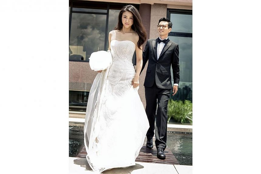 Chinese actress Tang Wei, 34, went for an unadorned look for her wedding with South Korean director Kim Tae Yong, 44, in pictures released today.-- PHOTO: TANG WEI