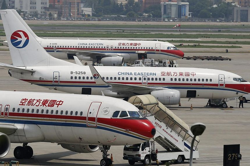 China Eastern Airlines planes are seen on the tarmac at Hongqiao International Airport in Shanghai, on July 29, 2014. -- PHOTO: REUTERS