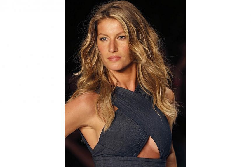 Brazilian top model Gisele Bundchen presents a creation from Colcci's Summer 2015 collection at Sao Paulo Fashion Week in Sao Paulo in this file photo from April 2, 2014. -- PHOTO: REUTERS