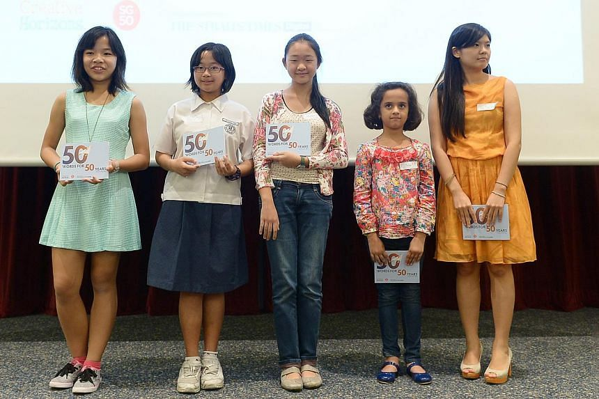The five category winners of Paper Planes 2014: 50 Words For 50 Years: (from left) Leong Jo Yie, Victoria Ong Dai Qi, Madeleine Fung Sum Yee, Meher Narang, Luo Junjia (not present, represented by his sister Luo Ping Xi) -- ST PHOTO: NG SOR LUAN