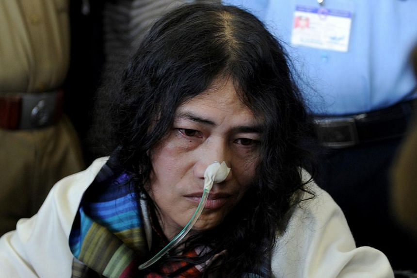 In this photograph taken on March 3, 2013 social activist from Manipur, Irom Sharmila, who has been on a fast for 12 years demanding the repeal of the controversial Armed Forces Special Powers Act (AFSPA), arrives at the Indira Gandhi International A