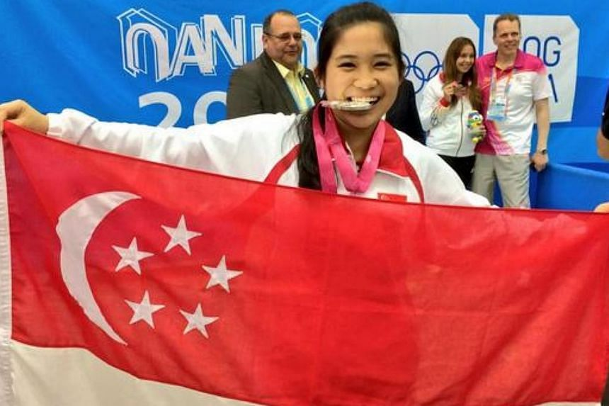 Martina Lindsay Veloso with her silver medal. -- ST PHOTO: MAY CHEN