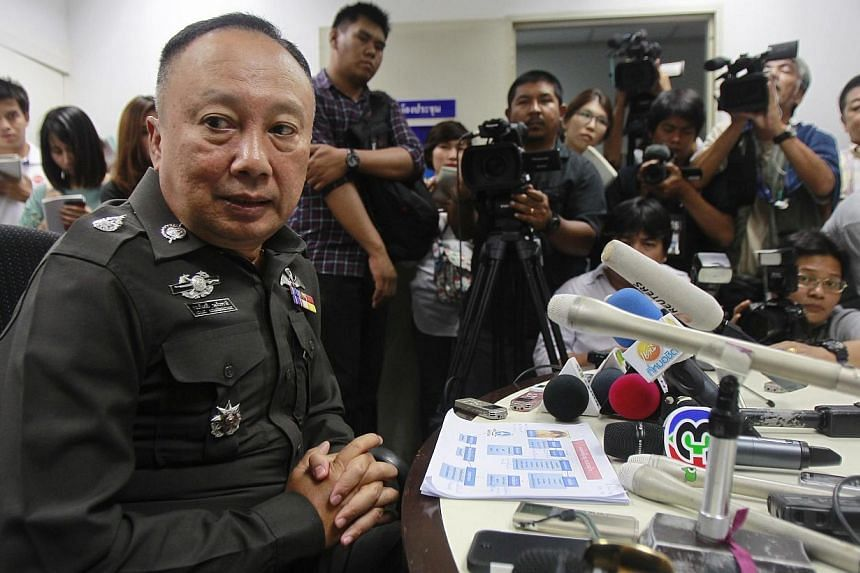 Thai assistant national police chief, Lieutenant General Korkiat Wongworachart speaks during a news conference at the Royal Thai Police headquarters in Bangkok on Aug 20, 2014. A DNA test of a Japanese man embroiled in a surrogacy scandal in Tha