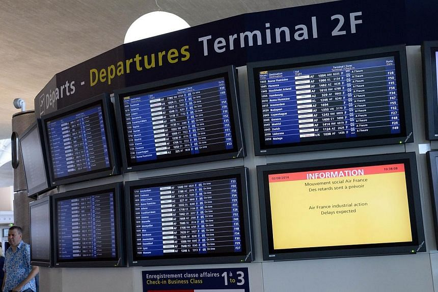 A photo taken on Aug 2, 2014 shows information and departure boards at the Roissy-Charles-de-Gaulle airport, in Roissy-en-France.Some Air France flight crews are refusing to board planes bound for Guinea, Sierra Leone and Nigeria over fears of