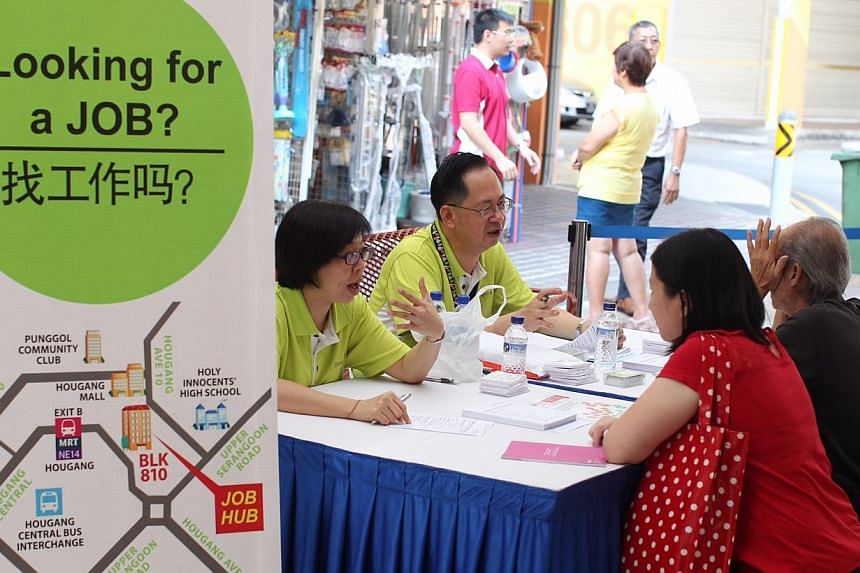 Two residents talking to recruiters at the job fair organised by the North East Community Development Council at Hougang Central Court on 16 April 2014.Small businesses in Tampines, who have been finding it hard to hire workers, were given a he