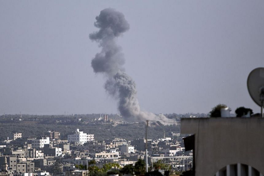 Smoke billows following an Israeli military strike on Gaza City on August 19, 2014. Israel ordered its negotiators back from talks in Cairo and warplanes hit Gaza after Palestinian rockets smashed into the south as the two sides were observing a 24-h
