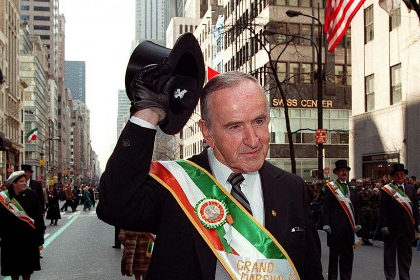 A file picture taken on March 17, 1998, shows former Irish prime minister Albert Reynolds raising his hat to the crowd during the St Patrick's Day parade in New York. Mr Reynolds, a central figure in the Northern Ireland peace process who helped