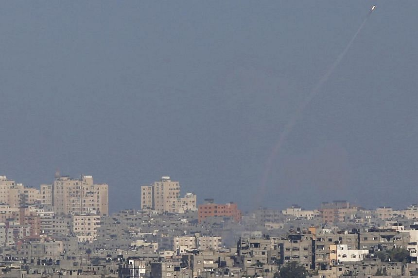 A smoke trail is seen as a rocket is launched from the Gaza Strip towards Israel on Aug 20, 2014. -- PHOTO: REUTERS