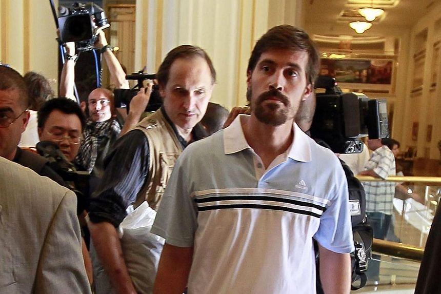 US journalist James Foley (right) arrives with fellow reporter Clare Gillis (not pictured), after being released by the Libyan government, at Rixos hotel in Tripoli, in this picture taken on May 18, 2011. The United States Justice Department is
