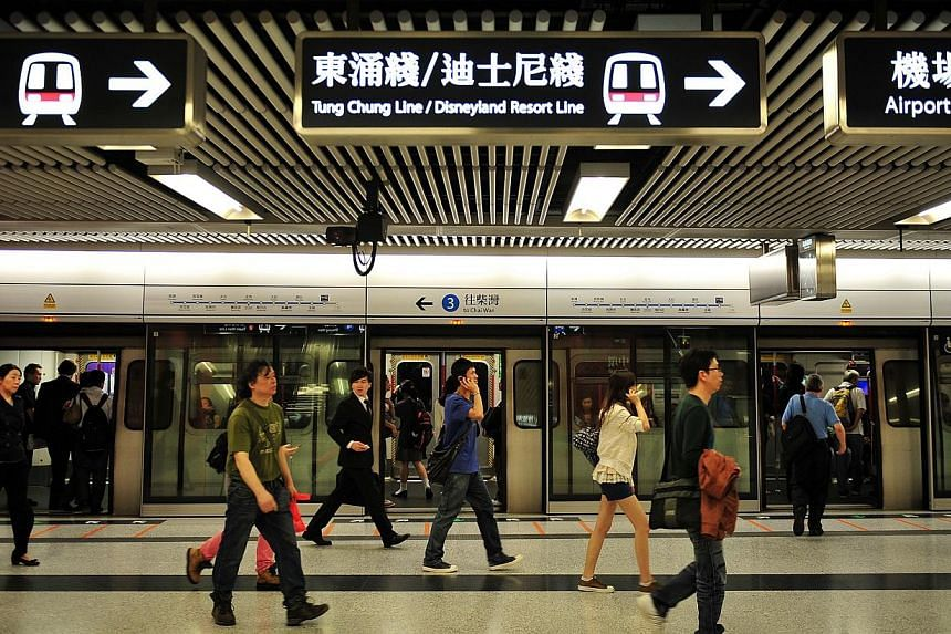 Commuters in a Mass Transit Railway (MTR) station in Hong Kong.Hong Kong's animal lovers heaped fury on the city's subway operator on Thursday, Aug 21, 2014, after rail workers failed to stop a dog from being run over by a train. -- PHOTO
