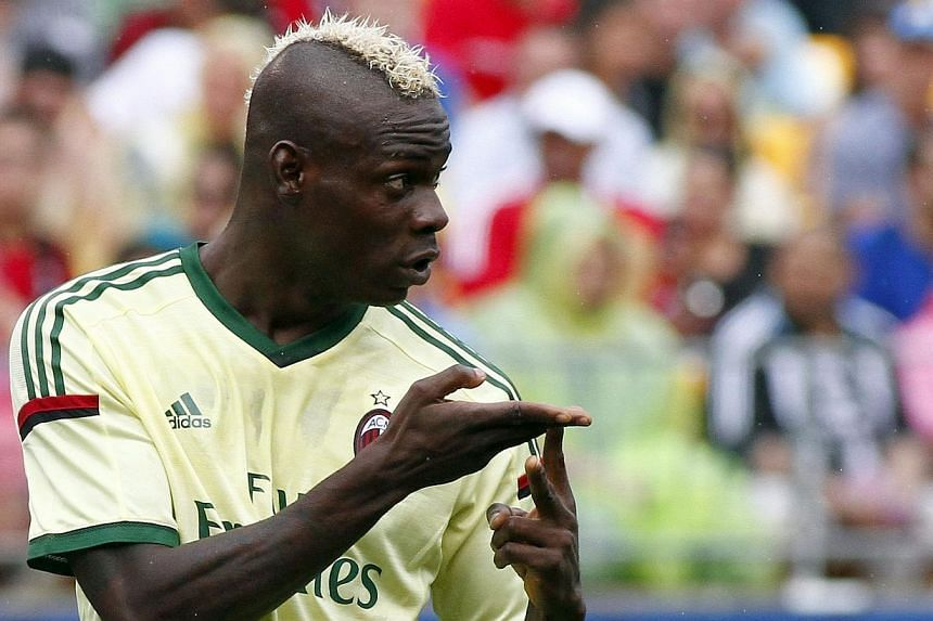 Mario Balotelli of AC Milan signals to teammates against Manchester City during International Champions Cup 2014 at Heinz Field on July 27, 2014, in Pittsburgh, Pennsylvania. -- PHOTO: AFP
