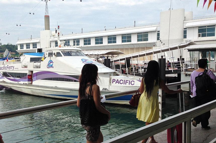 Passengers boarding a ferry heading for Batam. Some Singaporeans say they are unfazed by the strict rules.