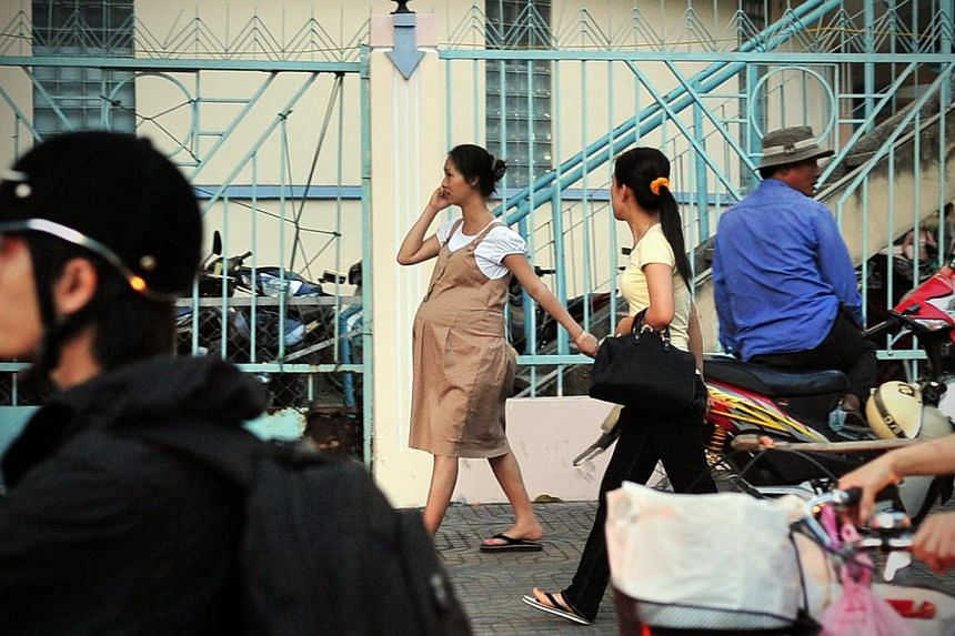 Migration can strain the family unit. In Vietnam, about half of female migrants to Hanoi and Ho Chi Minh City (above) are married, and over 80 per cent of those married when they first move have at least one child.