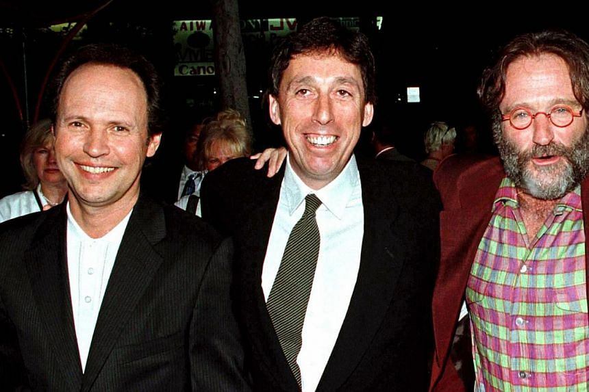 Hollywood director Ivan Reitman (centre) poses with Robin Williams (right) and Billy Crystal as they arrive for the premiere of their movie Father's Day at Mann's Chinese Theatre in Hollywood in this file picture taken May 6, 1997. Crystal and Willia
