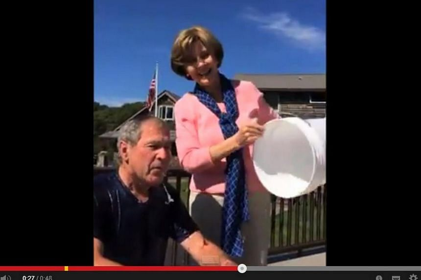 Former US president George W. Bush is doused in ice water by wife Laura as part of the so-called Ice Bucket Challenge in support of Lou Gehrig's disease research on Wednesday. He nominated former US president Bill Clinton to take the challenge. &nbsp