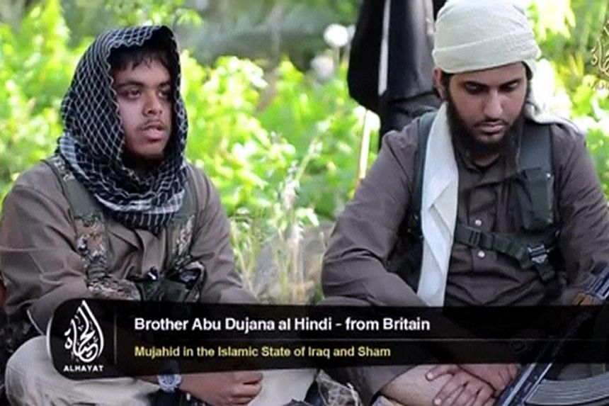 An Islamist fighter, identified as Abu Bara' al-Hindi from Britain (left), speaks in this still image taken from an undated video shot at an unknown location and uploaded to a social media website on June 19, 2014. He is among 400-500 British nationa