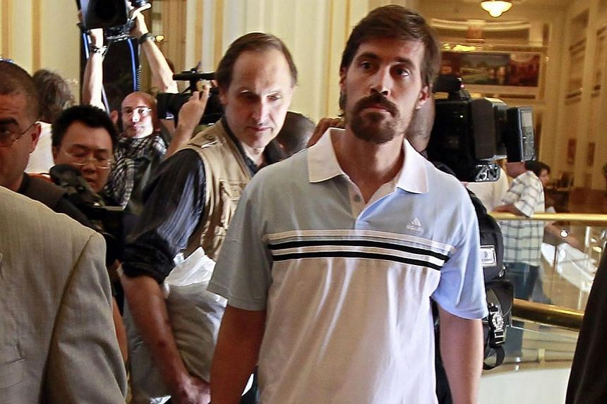 US journalist James Foley (right) arrives with fellow reporter after being released by the Libyan government, at Rixos hotel in Tripoli, in this picture taken on May 18, 2011. -- PHOTO: REUTERS