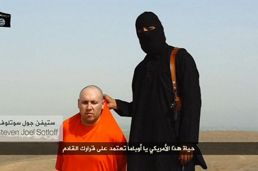 The US airstrikes come amid Islamic State militants' threats to killUS journalist Steven Sotloff, seen here in a still from a video released online on Tuesday which also showed the beheading by militants of US journalist James Foley in retaliat