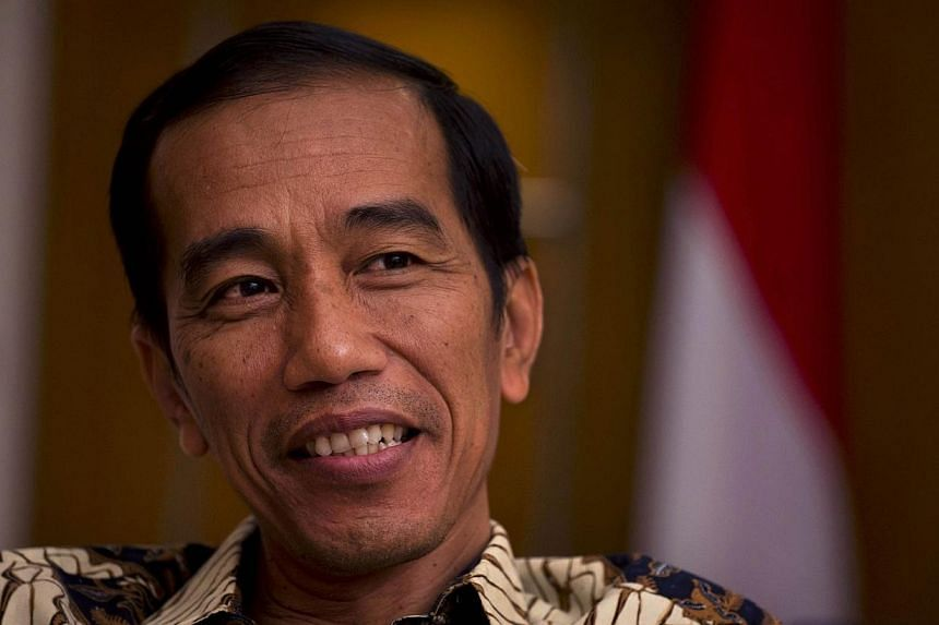 President-elect Joko Widodo will sit down with Indonesia's outgoing leader next week in the hope of reaching an agreement to raise fuel prices before the handover in October, a move that would help ease budget-sapping subsidy costs. -- PHOTO: AFP