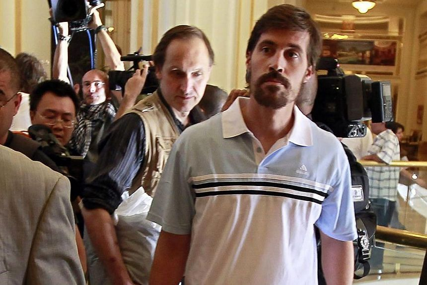 US journalist James Foley (right) arrives with fellow reporter Clare Gillis (not pictured), after being released by the Libyan government, at Rixos hotel in Tripoli on May 18, 2011. -- PHOTO: REUTERS