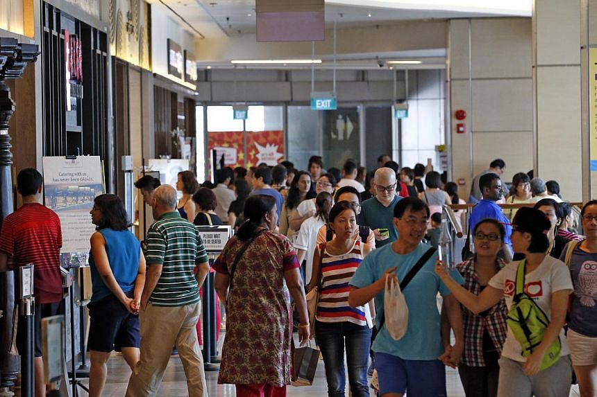 The basement of Suntec City Mall near the Fountain of Wealth was packed on Sunday. Tenants say consumer traffic has improved since the section reopened last year.