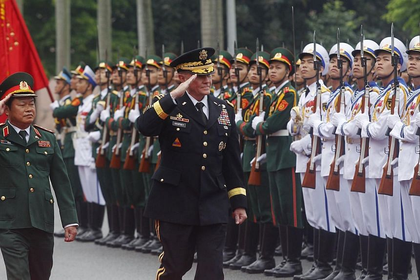General Martin Dempsey and his Vietnamese counterpart, Senior Lieutenant-General Do Ba Ty, reviewing the guard of honour during a welcoming ceremony held at the Defence Ministry in Hanoi on Aug 14. Gen Dempsey's visit to Vietnam earlier this month -