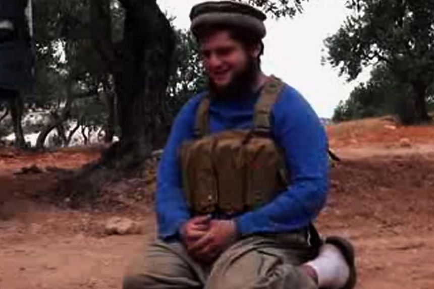 An image grab taken from a video released via Al-Nusra's official channel Al-Manara Al-Baydaa on July 25, 2014, shows a young US suicide bomber from Florida who blew himself up at an army post in the northwest of Syria. -- PHOTO: AFP
