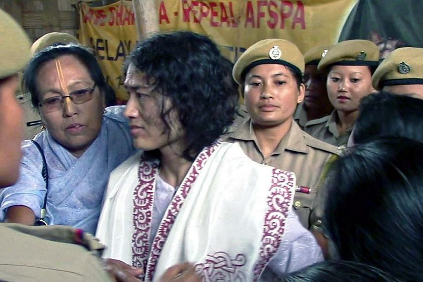 Indian rights activist Irom Sharmila, who has been on hunger strike for fourteen years, being led by policewomen after her rearrest at the site of her protest in Imphal, capital of India's north-eastern Manipur state, on August 22, 2014. Indian polic