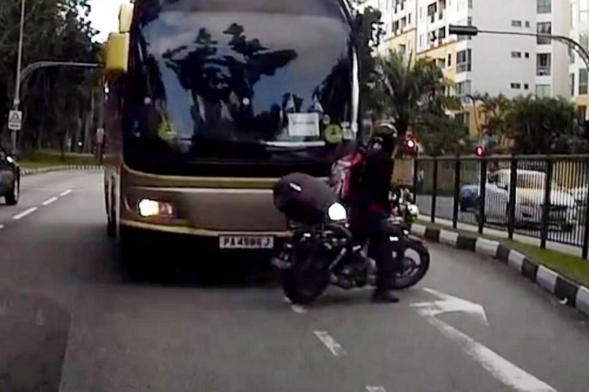 A screengrab from a video clip showing a bus, which was going against the flow of traffic, crashing into a motorcycle. -- PHOTO: SINGAPORE RECKLESS DRIVERS/YOUTUBE