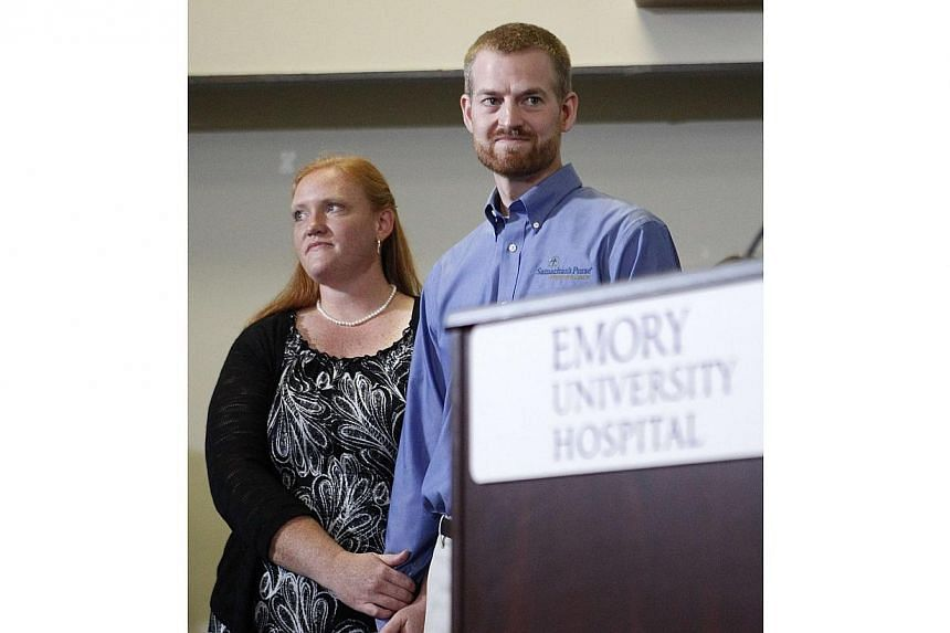 Dr Kent Brantly, who contracted the deadly Ebola virus, stands with wife Amber during a press conference at Emory University Hospital in Atlanta, Georgia on Aug 21, 2014. -- PHOTO: REUTERS