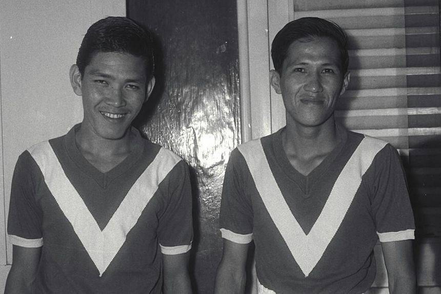 Former Singapore football team captain Lee Kok Seng (right), seen here with teammate Umar Rahmat at the Jalan Besar Stadium in 1960, died yesterday from pneumonia. -- PHOTO: ST FILE