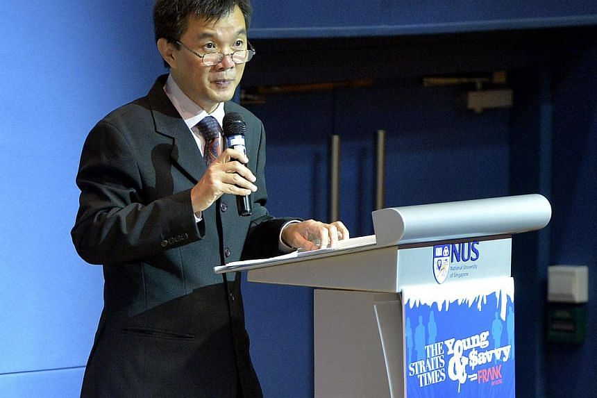 ST senior correspondent Goh Eng Yeow addressing the audience. The Straits Times Young and Savvy talk on personal finance and investing at the Shaw Foundation Alumni House auditorium of the National University of Singapore (NUS) was the first in