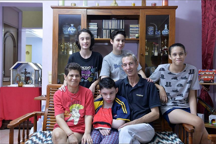 The Welfords - (clockwise from right above) Alexandria, dad John, Ashley, mum Elisa, Victoria and Nicole - and the Chans - (from far left) Yi Xuan, mum Teoh Geik Luang, Yu Fan, dad Ming Kiat and Yu Heng - are among families here who cannot afford to