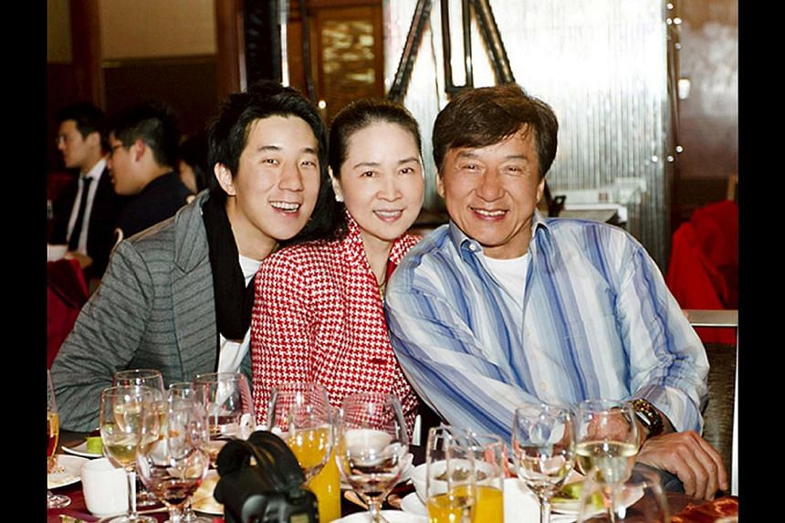 Jaycee Chan with his parents (above), former actress Lin Feng-jiao and action superstar Jackie Chan, in 2012 at her 60th birthday party and with his father in 2008. -- PHOTO: ONE HOUSE
