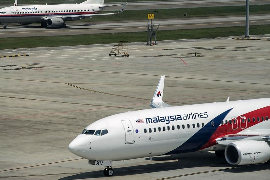 This file photo taken on July 21, 2014 shows Malaysia Airlines planes on the tarmac at Kuala Lumpur International Airport in Sepang. -- PHOTO: AFP