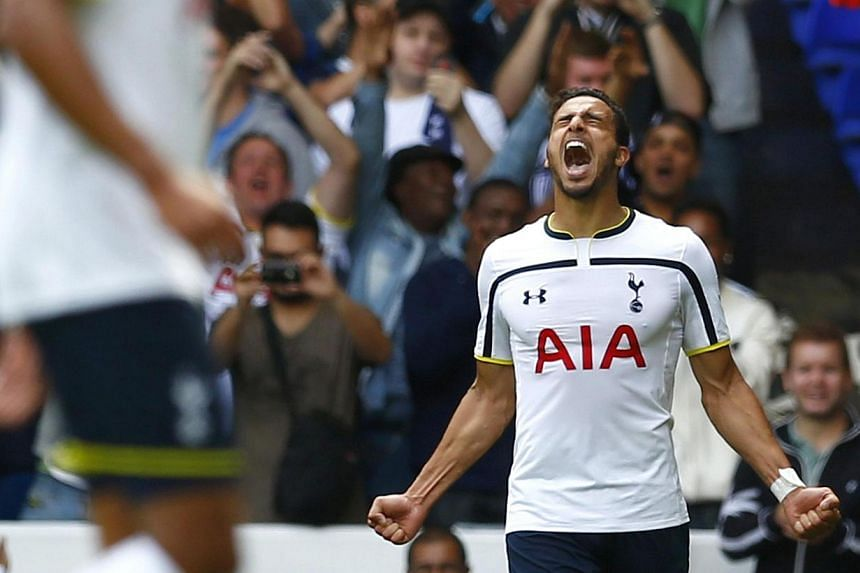 Tottenham Hotspur's Nacer Chadli (right) celebrates after scoring his second goal against Queens Park Rangers during their English Premier League soccer match at White Hart Lane in London on Aug 24, 2014. Nacer Chadli ruined Harry Redknapp's ret