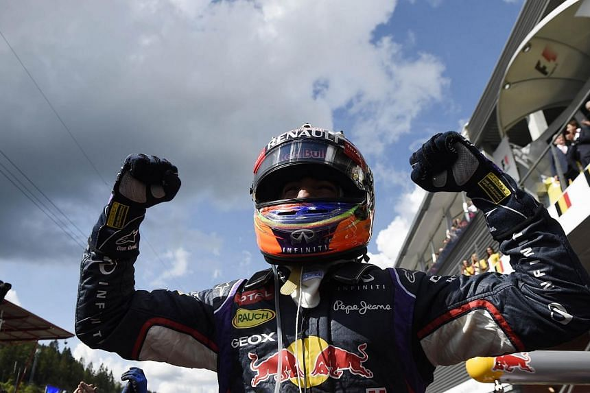 Red Bull Racing's Australian driver Daniel Ricciardo celebrates in the parc ferme at the Spa-Francorchamps circuit in Spa on Aug 24, 2014, after the Belgium Formula One Grand Prix.Australian Daniel Ricciardo claimed his third race victory of th