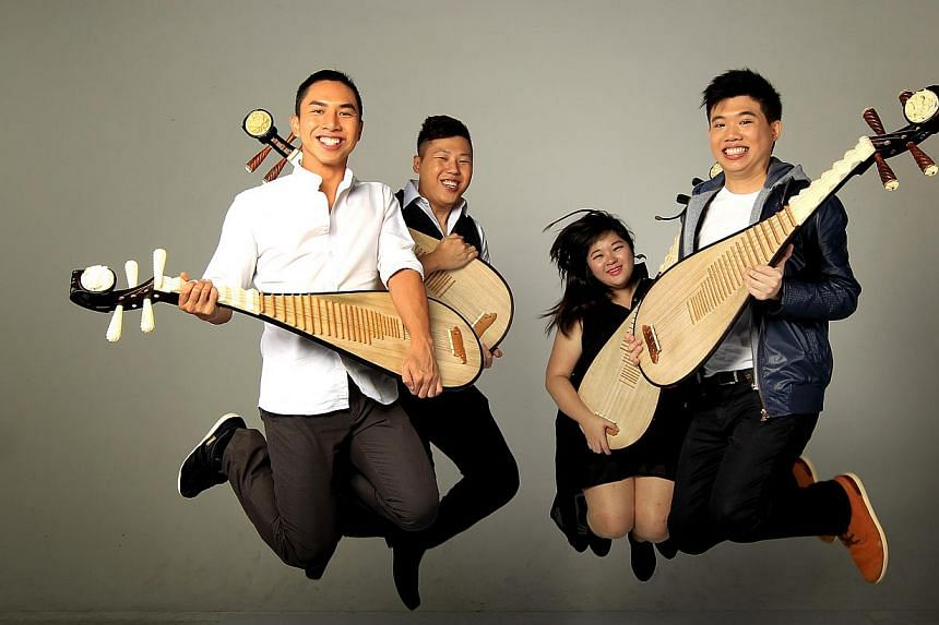 The Pipa Quartet, formed in 2013, comprising (from left) Samuel Wong Shengmiao, Ivan Chng Wei Jie, Goh Xue Qi and Jeremy Wong Xin Rui. -- PHOTO: ST FILE