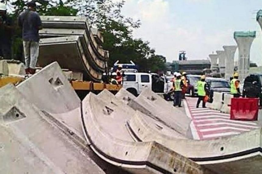 Several precast concrete blocks, meant for Malaysia's MRT line in Petaling Jaya, fell off the trailer transporting them onto a road, causing a traffic congestion that lasted for more than three hours. This took place just a week after a 690-tonne ove
